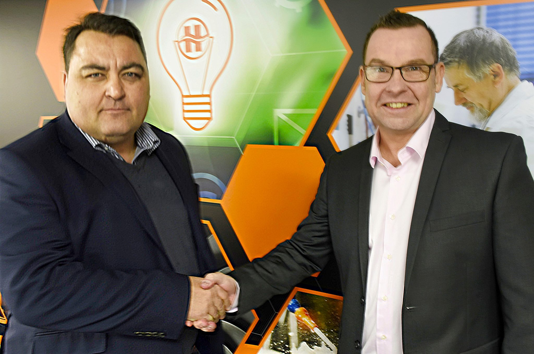 Photograph of Lee Bowditch and Matthew Bartle Shaking Hands